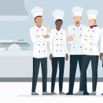 In der Küche des Restaurants stehen professionelle Köche zusammen